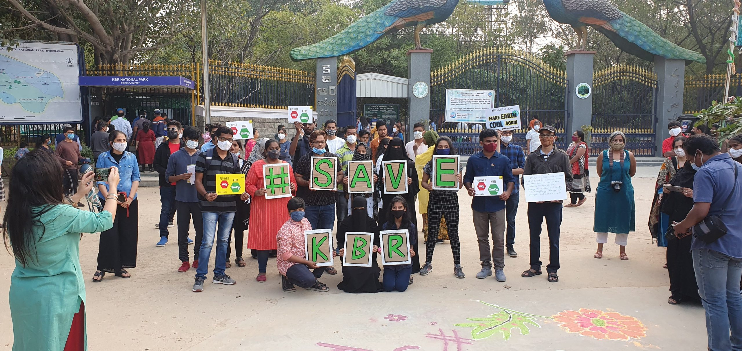 Activists stood with Save KBR spelt in signs.